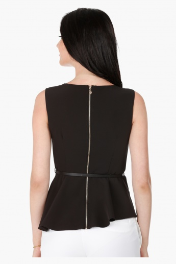 Elle Sleeveless Peplum Top with Boat Neck in Regular Fit