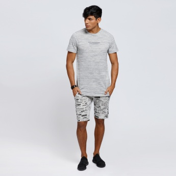 Melange Printed T-Shirt with Crew Neck and Asymmetric Hem